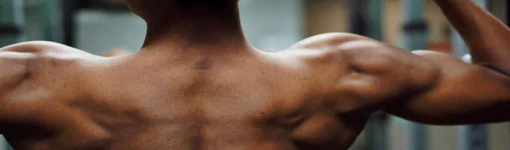 bredere schouders krijgen